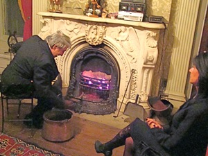michael halberian feeding coal into the marble fireplace