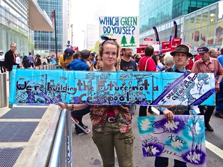 climate change marchers signs photos
